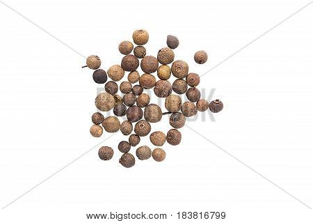 A Scattering Of Allspice On A White Background