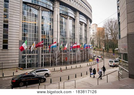 BRUSSELS, BELGIUM. January 25, 2017. Flags of European Union member states in front of the European Parliament building in Brussels.