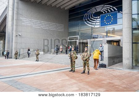 BRUSSELS, BELGIUM. January 25, 2017. Belgium army soldiers guarding the European Parliament headquarters. Brussels terror threat stock image. Emergency alert.