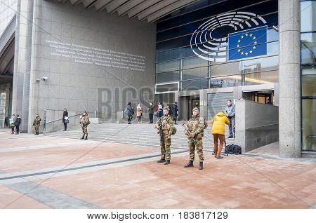 BRUSSELS, BELGIUM. January 25, 2017. Belgium army soldiers guarding the European Parliament headquarters. Brussels terror threat stock image. Emergency alert.