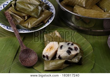 Streamed Sticky Rice And Black Bean In Banana Leaf .