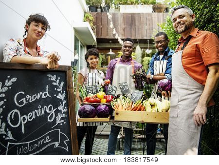 Group of friends with vegetable shop together