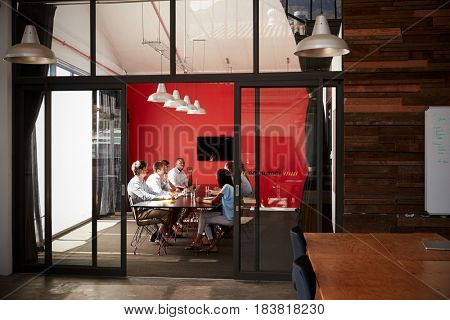 Team in a meeting at a creative business boardroom
