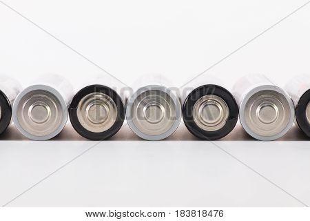 Energy abstract background of white and black batteries. AA size alkaline battery.