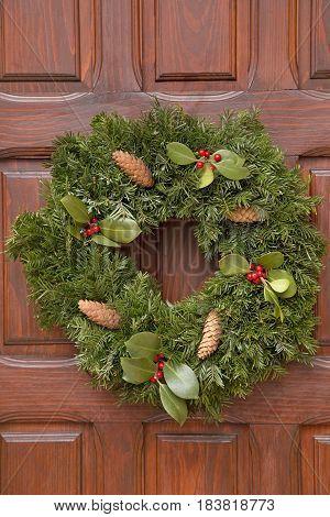 The Christmas wreath on a wooden door