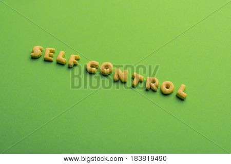 Self Controt Concept,  Words Made Of Cookies Isolated On Green. Healthy Lifestyle And Healthy Living
