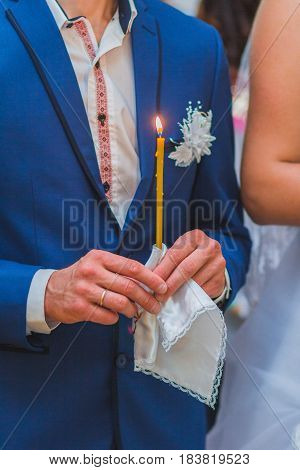 Newlyweds Are Holding Candles On The Wedding Ceremony