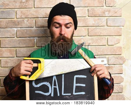 Bearded Worker Man Holding Various Building Tools With Surprised Face