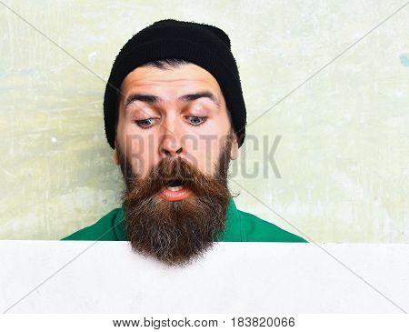 Bearded Man Posing On Studio Wall Background