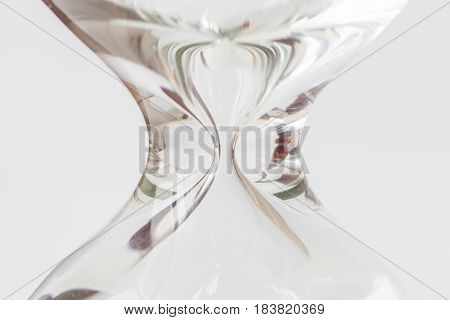 Close up body shape symmetry of hourglass or sandglass on white background.