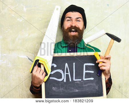 Bearded Foreman Holding Various Building Tools And Board, Happy Face