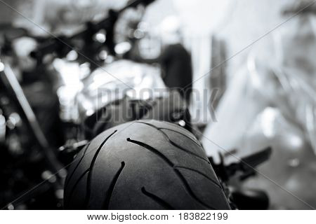 Art of riding fast. Modern professional rubber shoes of a vehicle lying in garage and lines on a tire forming a special pattern