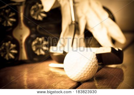 Closeup of Golf Shoe Spikes with Glove, Ball, Tee and Putter