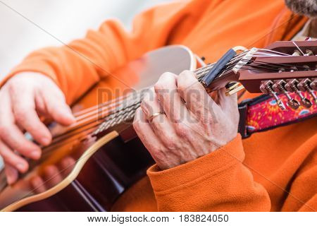 Playing and strumming beautiful electric lute guitar (Oud) close up