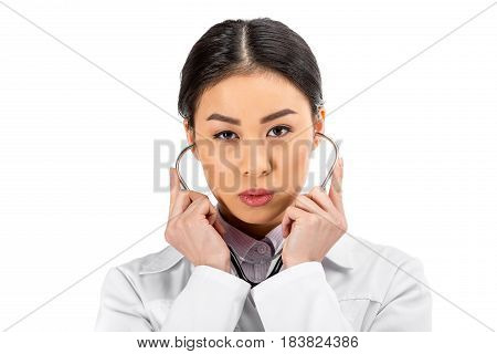 Asian Female Doctor Standing With Stethoscope In White Coat Isolated On White