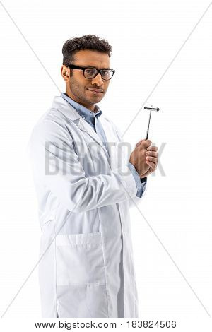Young Professional Doctor In Eyeglasses Holding Reflex Hammer Isolated On White