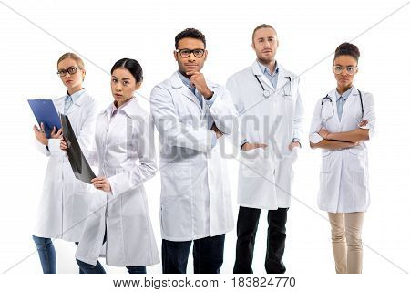 Group Of Young Confident Professional Doctors Standing Together Isolated On White