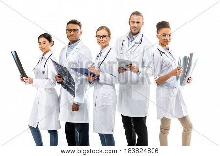 Group Of Young Smiling Professional Doctors Standing Together Isolated On White
