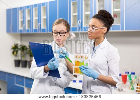 Portrait Of Scientists Working With Test Tubes, Laboratory Researcher Concept