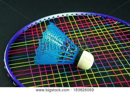 Color badminton equipment with black background, detail