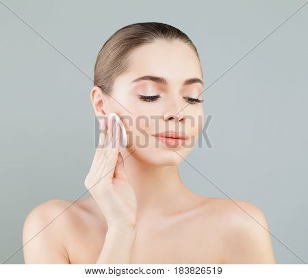 Beautiful Healthy Woman with White Cotton Pads. Hygienic Cleansing and Facial Treatment Concept