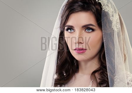 Cute Fiancee with Make up Bridal Hairstyle and Veil. Classic Style