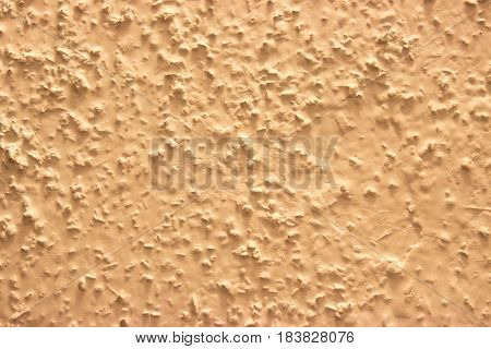 Coarse grained wall paint in cream color - exterior