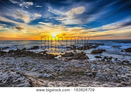 Beautiful scenery on the sea shore the waves and sunset