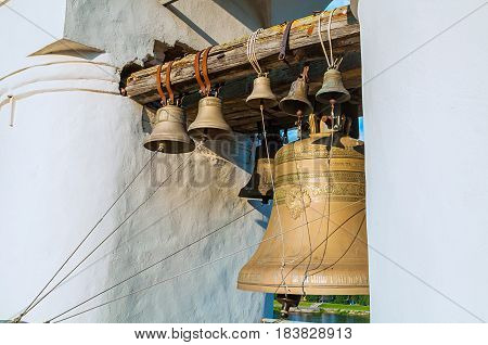 Bells in the span of the belfry of Saint Sophia Cathedral in Veliky Novgorod Russia. Closeup of church bells in St Sophia cathedral belfry, Veliky Novgorod, Russia