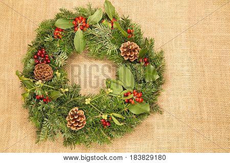 The Christmas wreath on grunge burlap background
