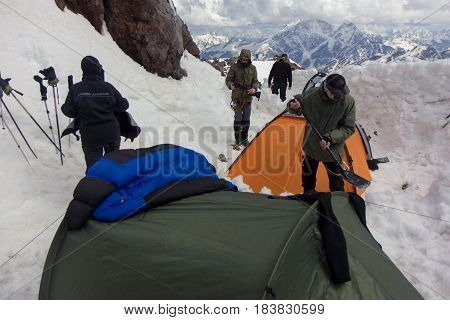 2014 Mount Elbrus, Russia: climbing to the top with a disabled person. View on the rocks of Pastukhov