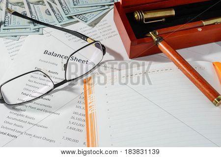 business statistics, balance sheet phone and money