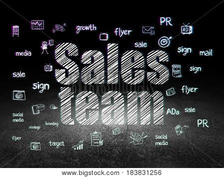Marketing concept: Glowing text Sales Team,  Hand Drawn Marketing Icons in grunge dark room with Dirty Floor, black background