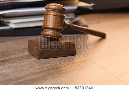 Photo of hammer against documents