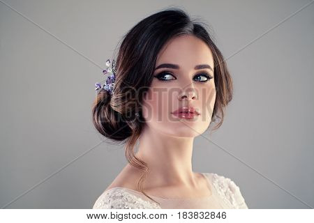 Beautiful Bride with Wedding Hairstyle and Make up. Studio Portrait of Young Gorgeous Bride. Perfect Fiancee