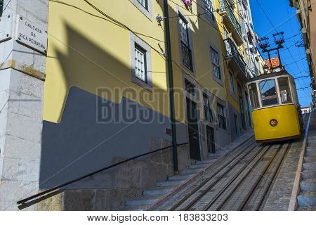 Yellow Bica Elevator (Elevador da Bica) in the historic neighborhood of Bica in Lisbon Portugal; Concept for travel in Lisbon