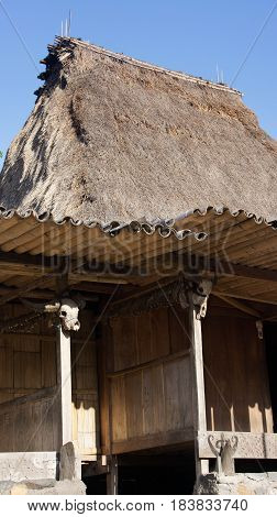 Cow skull detail of hut in Bena a traditional village with grass huts of the Ngada people in Flores near Bajawa Indonesia.