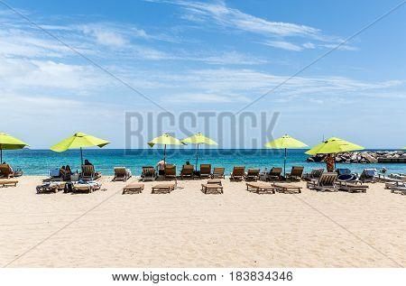 Green Umbrellas On St Kitts Beach