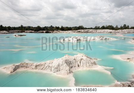 Man-made artificial lake Kaolin turned from mining ground holes. Due to mining holes were formed covered by rain water forming a clear blue lake Air Raya Village Tanjung Pandan Belitung Island.