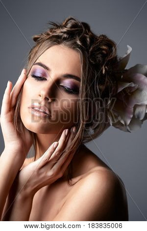 Portrait of a gorgeous young woman with bright make-up and stylish hair. Beauty, makeup and cosmetics concept.