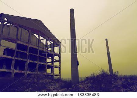 Ruins of an abandoned factory at sunset