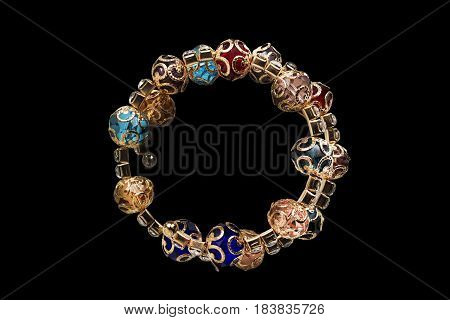 Colorful crystals golden bracelet isolated over black