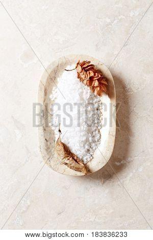 Natural organic bath salt in a marble dish