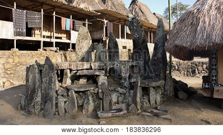 Stone tablets in Bena a traditional village with grass huts of the Ngada people in Flores near Bajawa Indonesia.