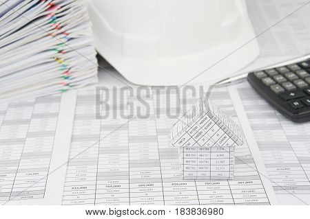 House With Blur White Engineer Hat And Pile Overload Document