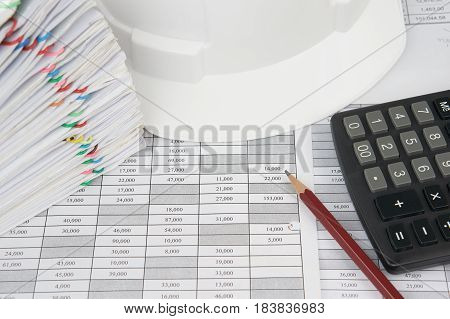 Pencil And Calculator With Blur White Engineer Hat And Document
