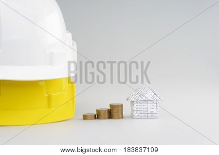 Step Pile Gold Coins Between House And Engineer Hat