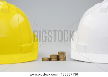Step Pile Gold Coins Between Yellow And White Engineer Hat