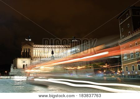 Altar of the Fatherland or Monumento Nazionale a Vittorio Emanuele II (National Monument to Victor Emmanuel II) in Rome, Italy, with night traffic