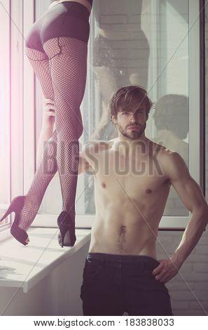 Handsome Sexy Macho Hugging Female Legs